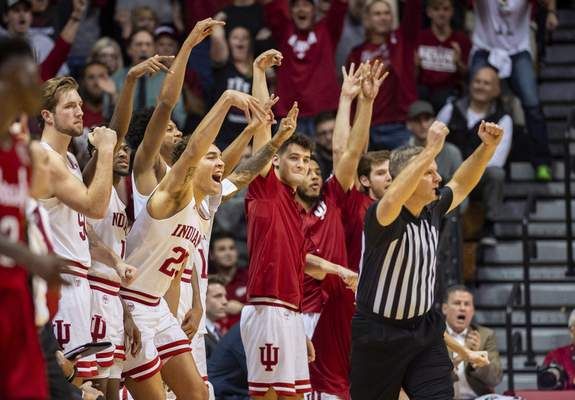 Players on the Indiana bench react as Robert Phiniseehits a 3-pointer during overtime of the Hoosiers' 96-90 win over Nebraska. Phinisee had seven points in the extra period. (AP Photo/Doug McSchooler)