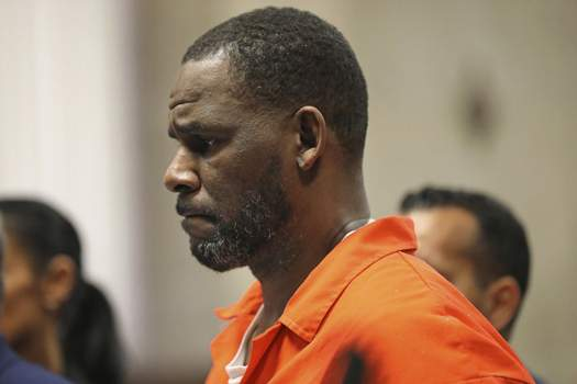 Not Real News FILE - In this Sept. 17, 2019 file photo, R. Kelly appears during a hearing at the Leighton Criminal Courthouse in Chicago. On Friday, Dec. 13, 2019, The Associated Press reported on stories circulating online incorrectly asserting that Kelly was sentenced to 104 years in prison. The 52-year-old singer, who is in federal custody, hasn't been sentenced. (Antonio Perez/Chicago Tribune via AP, Pool) (Antonio Perez POOL)
