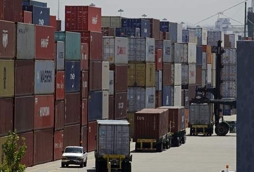 """China US Trade FILE - In this July 22, 2019, file stacked containers wait to be loaded on to trucks at the Port of Oakland in Oakland, Calif. China's government says trade negotiators are in """"close communication"""" with Washington ahead of a weekend deadline for a U.S. tariff hike. But a Ministry of Commerce spokesman gave no indication of possible progress in trade talks or whether Washington might postpone the increase. (AP Photo/Ben Margot, File) (Ben Margot STF)"""