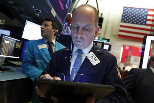 Financial Markets Wall Street FILE - In this Dec. 5, 2019, file photo trader Michael Urkonis works on the floor of the New York Stock Exchange. The U.S. stock market opens at 9:30 a.m. EST on Friday, Dec. 13. (AP Photo/Richard Drew, File) (Richard Drew STF)