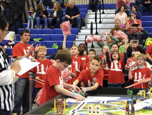 Katie Fyfe | The Journal Gazette  Jane Ball Elementary students cheer each other on during the20th edition of the FIRST LegoLeague's Northern Indiana ChampionshipatPurdue University Fort Wayne on Saturday.