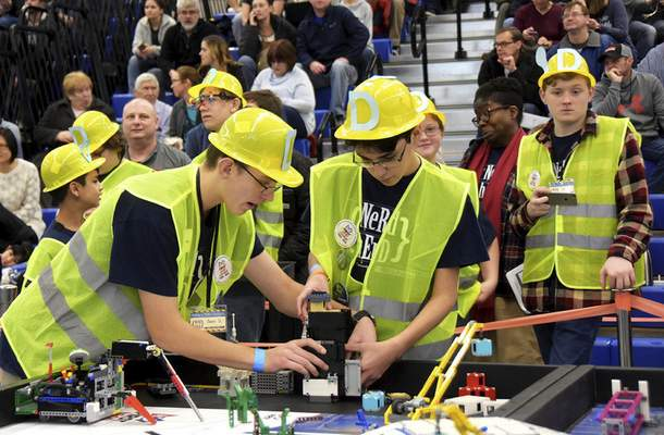 Katie Fyfe | The Journal Gazette  Sean Sharp and Alex Fischer get their Lego robot ready to compete during the20th edition of the FIRST LegoLeague's Northern Indiana ChampionshipatPurdue University Fort Wayneon Saturday.