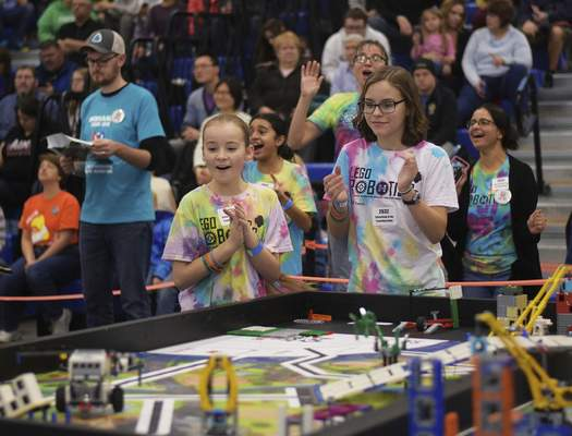 Katie Fyfe | The Journal Gazette  Charolette Regan, left, and Jenna Krieg watch in excitement as their Lego robotnavigates an obstacle courseduring the20th edition of the FIRST LegoLeague's Northern Indiana ChampionshipatPurdue University Fort Wayne.
