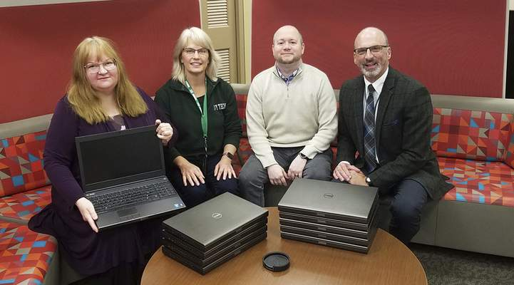 Ivy Tech Warsaw students can participate in a laptop-loan-to-own program through Lake City Bank. Chris Merrill, third from left, is with Lake City Bank. Christine Force, left, Kathy Perry and Allyn Decker are with Ivy Tech.