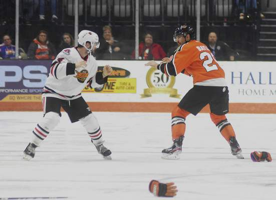 Katie Fyfe | The Journal Gazette The Komets' Stephen Baylis and Indy's Michael Doherty square off for a fight in the second period Friday night.