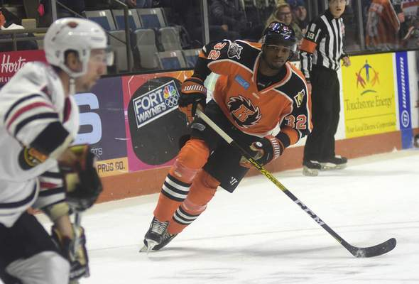 Katie Fyfe | The Journal Gazette  The Komets' Jermaine Loewen chases after the puck during the second period against the Indy Fuel at Memorial Coliseum on Friday.