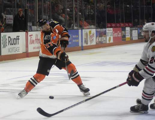Katie Fyfe | The Journal Gazette  The Komets' Shawn Szydlowski tries to shootthe puck during the second period against the Indy Fuel at Memorial Coliseum on Friday.
