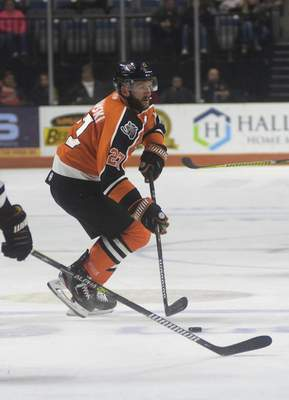 Katie Fyfe | The Journal Gazette  The Komets' Shawn Szydlowskicontrols the puck during the second period against the Indy Fuel at Memorial Coliseum on Friday.
