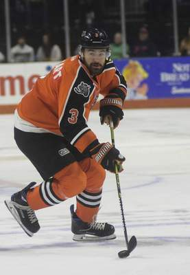 Katie Fyfe | The Journal Gazette  The Komets' Chase Stewart carries the puck during the second period against the Indy Fuel at Memorial Coliseum on Friday.