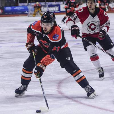 Mike Moore | The Journal Gazette Komets forward Taylor Ross makes a move to the net in the first period against Cincinnati at Memorial Coliseum on Saturday.