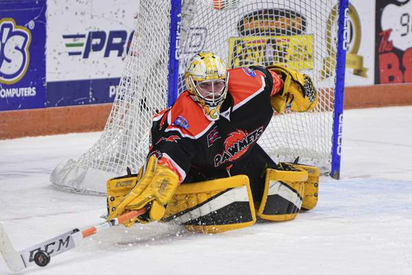 Mike Moore | The Journal Gazette Komets goaltender Patrick Munson reaches out to make a stop during the first period of Saturday's game against Cincinnati.