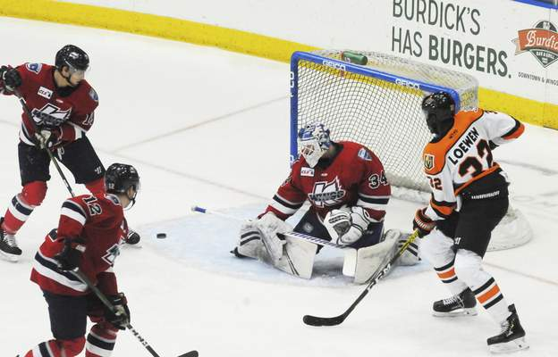 Justin A. Cohn | The Journal Gazette  Komets forward Jermaine Loewen, right, looks for the puck after Kalamazoo goaltender Jake Kielly, middle, makes a stop and Zach Frye, left, gets the rebound at Wings Event Center.