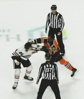 Justin A. Cohn | The Journal Gazette Komets forward Jermaine Loewen, right, fights the Indy Fuel's Jake Schultz at Memorial Coliseum.