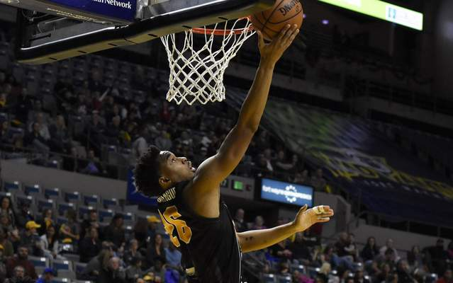 Rachel Von Stroup | The Journal Gazette  The Mad Ants' Ben Mooregoes in for a layup during the first quarter against the Erie BayHawks at Memorial Coliseum.