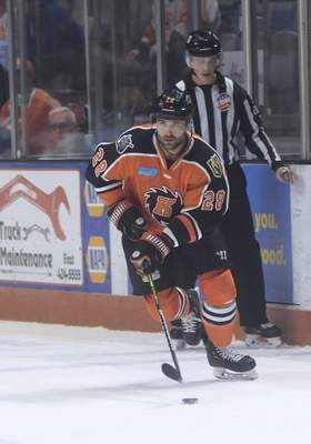 Katie Fyfe | The Journal Gazette  Komets' Matthew Boudens carries the puck during the first period against Kalamazoo Wings at Memorial Coliseum on Sunday.