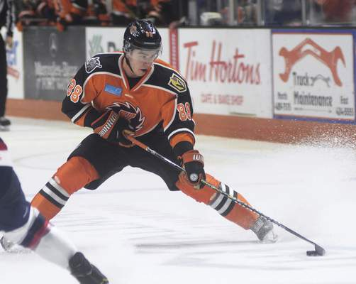 Katie Fyfe | The Journal Gazette  Komets' Alan Lyszczarczyk shoots and scores during the third period against Kalamazoo Wings at Memorial Coliseum on Sunday.