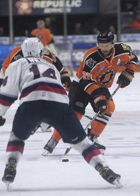 Katie Fyfe | The Journal Gazette  Komets' Shawn Szydlowski carries the puck during the third period against Kalamazoo Wings at Memorial Coliseum on Sunday.