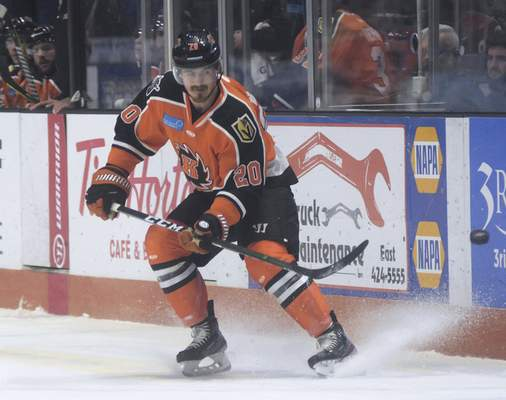 Katie Fyfe | The Journal Gazette  Komets' Stephen Baylis passes the puck during the first period against Kalamazoo Wings at Memorial Coliseum on Sunday.