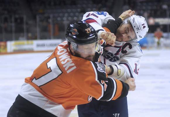 Katie Fyfe | The Journal Gazette  Komets' Shawn Szydlowski gets into a fight with Kalamozoo Wings Ben Wilson during the first period at Memorial Coliseum on Sunday.