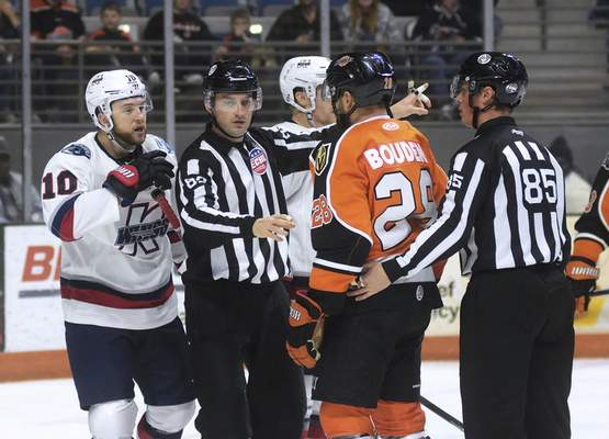 Katie Fyfe | The Journal Gazette  Referees have to split up Komets Matthew Boudens and Kalamazoo Wings Dylan Sadowy before a fight breaks out during the second period at Memorial Coliseum on Sunday.