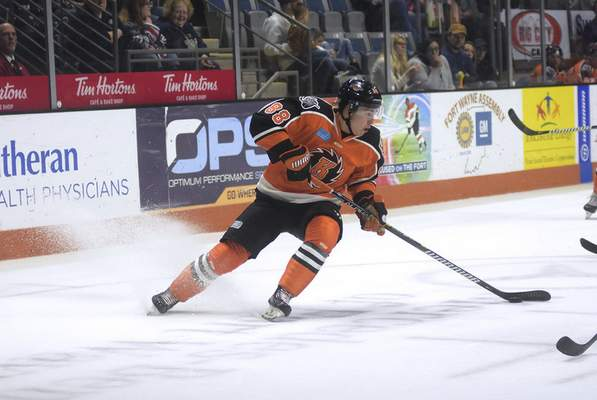 Katie Fyfe | The Journal Gazette  Komets' Alan Lyszczarczyk chases the puck during the second period against Kalamazoo Wings at Memorial Coliseum on Sunday.