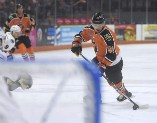 Katie Fyfe | The Journal Gazette  Komets' Taylor Ross carries the puck during the first period against Kalamazoo Wings at Memorial Coliseum on Sunday.