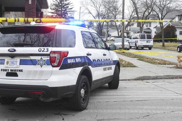 Michelle Davies | The Journal Gazette  Fort Wayne Police investigate the scene of a fatal shooting on Monday on Central Drive.
