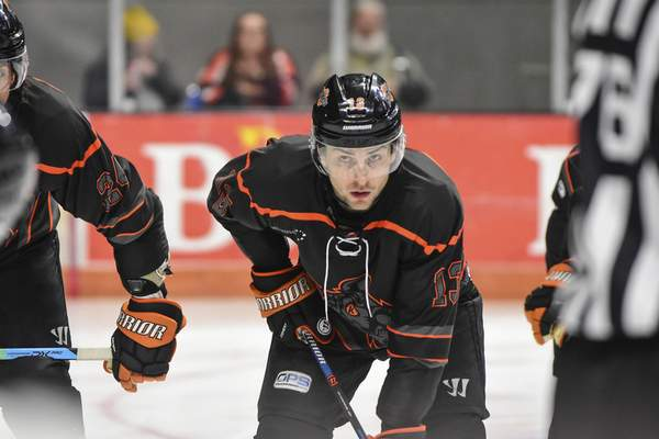 Mike Moore | The Journal Gazette Komets forward Anthony Petruzzelli waits for the puck to drop during a faceoff in the first period against Toledo at Memorial Coliseum on Tuesday.