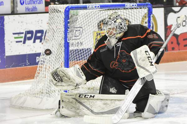 Mike Moore | The Journal Gazette Komets goaltender Cole Kehler reaches for a catch in the first period against Toledo at Memorial Coliseum on Tuesday.