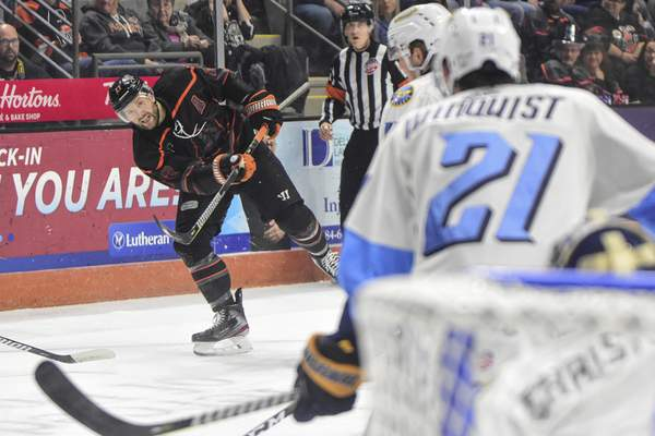 Mike Moore | The Journal Gazette Komets forward Shawn Szydlowski takes a shot at the net in the first period against Toledo at Memorial Coliseum on Tuesday.