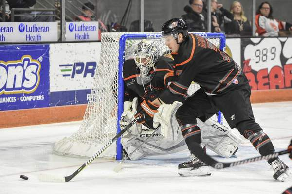 Mike Moore | The Journal Gazette Komets defenseman Brycen Martin assists goaltender Cole Kehler at the net in the first period against Toledo at Memorial Coliseum on Tuesday.