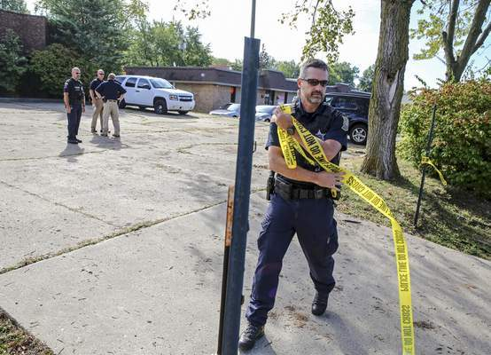 FILE: Officers from the Fort Wayne Police Department block the entrance to the site of the former abortion clinic operated by Dr. Ulrich Klopfer on Sept. 19, 2019, in Fort Wayne, Ind. (Eric Ginnard/The Herald-News via AP)