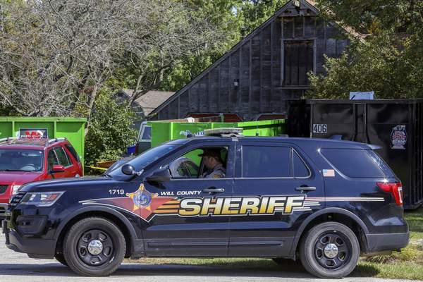 FILE: A Will County Sheriff's patrol is stationed outside the home of deceased Dr. Ulrich Klopfer on Sept. 19, 2019, in Unincorported Crete, Ill. (AP photo/Teresa Crawford)