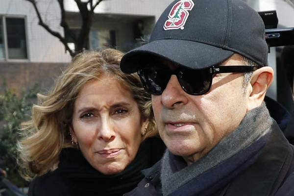 FILE - This March, 2019, file photo shows former Nissan Chairman Carlos Ghosn, right, and his wife Carole in Tokyo. (Kyodo News via AP, File)