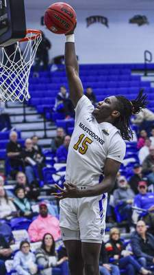 Mike Moore | The Journal Gazette Purdue Fort Wayne guard Deonte Billups drives to the basket in the first half against South Dakota at Hilliard Gates Sports Center on Wednesday.