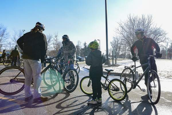 About 150 cyclists decided to ignore the cold temperatures Wednesday to take part in the New Year's Day tradition.