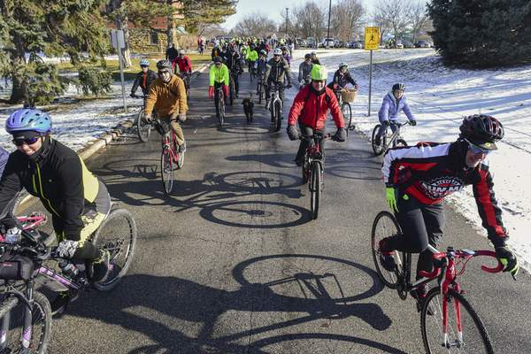 Mike Moore | The Journal Gazette Riders embark from Bob Arnold Northside Park on Wednesday for the annual Chilly Ride co-sponsored by 3 Rivers Velo Sport bicycling club and the Fort Wayne Parks and Recreation Department.