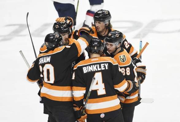 Rachel Von Stroup | The Journal Gazette  Komets players celebrate after their first goal against the Kalamazoo Wings during the first period at the Memorial Coliseum on Saturday night.