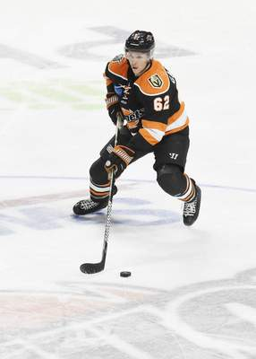 Rachel Von Stroup | The Journal Gazette  The Komets' Olivier Galipeauhandles the puck during the first period against the Kalamazoo Wings at Memorial Coliseum on Saturday night.