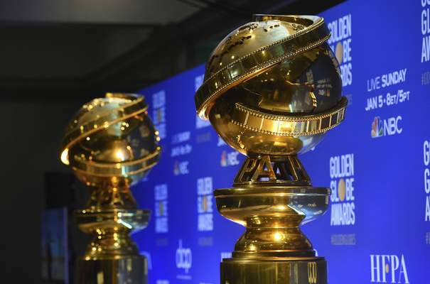 FILE - This Dec. 9, 2019 file photo shows replicas of Golden Globe statues at the nominations for the 77th annual Golden Globe Awards in Beverly Hills, Calif. (AP Photo/Chris Pizzello, File)