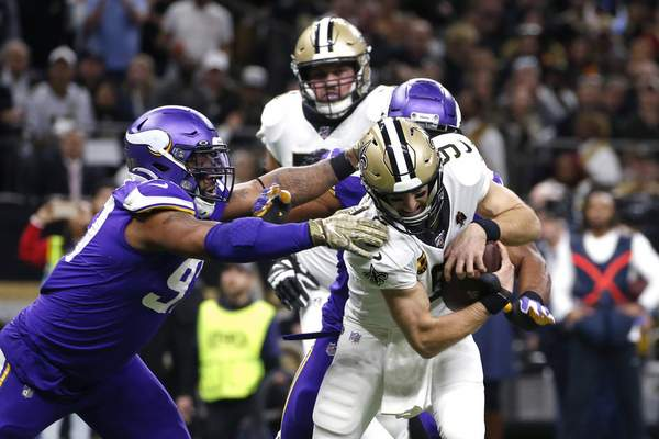 Associated Press Minnesota Vikings defensive end Danielle Hunter tries to tackle New Orleans Saints quarterback Drew Brees on Sunday in New Orleans.