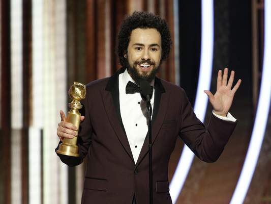 This image released by NBC shows Ramy Youssef accepting the award for best actor in a TV series, comedy or musical for