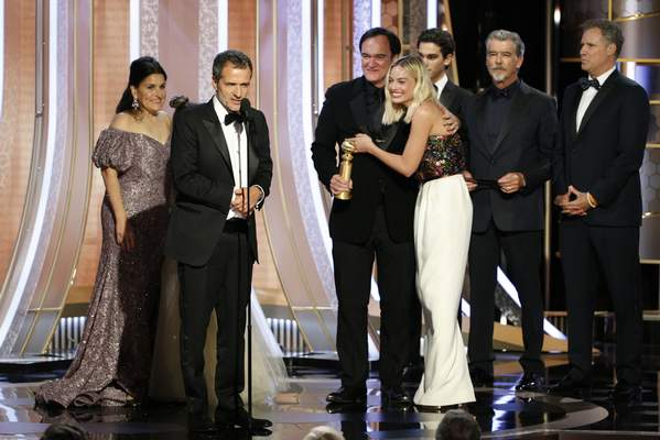 This image released by NBC shows Shannon McIntosh, from left, David Heyman, Quentin Tarantino and Margot Robbie accepting the award for best motion picture comedy for