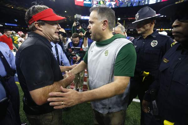 Georgia head coach Kirby Smart, left, greets Baylor head coach Matt Rhule after the Sugar Bowl NCAA college football game in New Orleans, Wednesday, Jan. 1, 2020. Georgia won 26-14. (AP Photo/Brett Duke)
