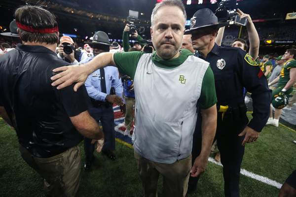 Baylor head coach Matt Rhule walks away after greeting Georgia head coach Kirby Smart after the Sugar Bowl NCAA college football game in New Orleans, Wednesday, Jan. 1, 2020. Georgia won 26-14. (AP Photo/Brett Duke)