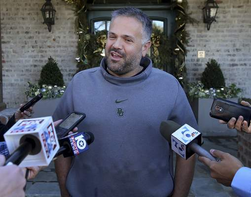 Former Baylor head football coach Matt Rhule speaks to reporters outside his home Tuesday Jan. 7, 2020, in Waco, Texas. (Jerry Larson/Waco Tribune-Herald via AP)