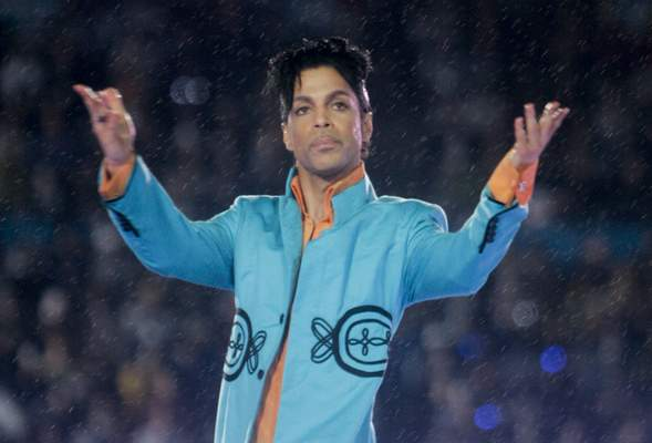 FILE - This Feb. 4, 2007 file photo shows Prince performing during the halftime show at the Super Bowl XLI football game at Dolphin Stadium in Miami. (AP Photo/David J. Phillip, File)