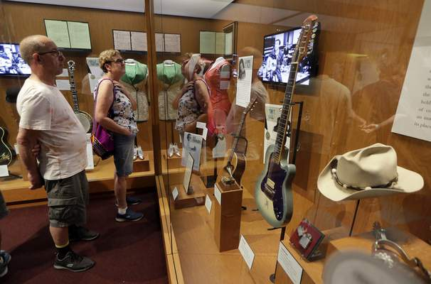 FILE - This May 25, 2018 file photo shows visitors to the Country Music Hall of Fame and Museum in Nashville, Tenn. (AP Photo/Mark Humphrey, File)
