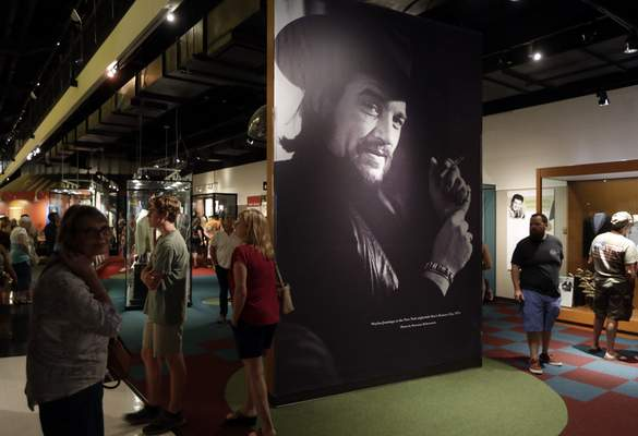 FILE - In this May 25, 2018 file photo, a portrait of Waylon Jennings is displayed as part of the Outlaws & Armadillos exhibit at the Country Music Hall of Fame and Museum in Nashville, Tenn. (AP Photo/Mark Humphrey, File)