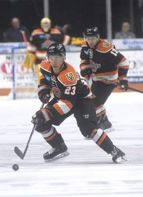 Katie Fyfe | The Journal Gazette  The Komets' Max Gottlieb chases the puck during the second period against the Idaho Steelheads at Memorial Coliseum on Friday.